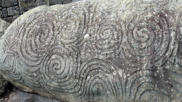 The tri-spiral pattern is deeply etched on the massive boulder located at the entrance to Newgrange. (Photo by Jennifer Robinson)